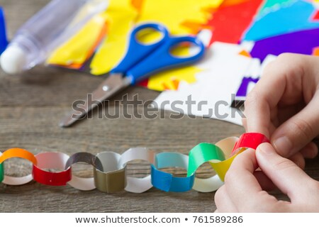 Stock photo: Making a paper chain of Christmas trees