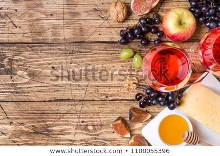 Vin rouge raisins côté table en bois alimentaire fête Photo stock © phila54