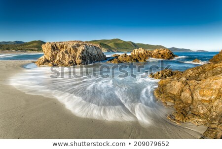 Ostriconi beach with Ile Rousse in background Stock photo © Joningall
