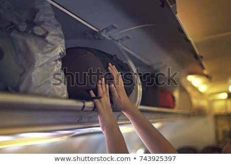 woman in luggage compartment stock photo © aikon