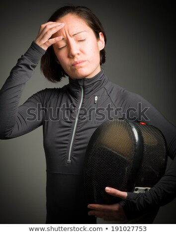 Stock photo: Female fencer suffering from headache