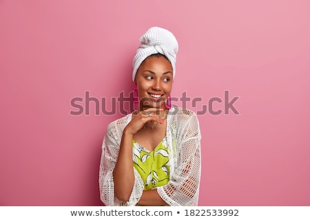 Woman Wearing White Bath Towel with Hand on Chin Stock photo © dash