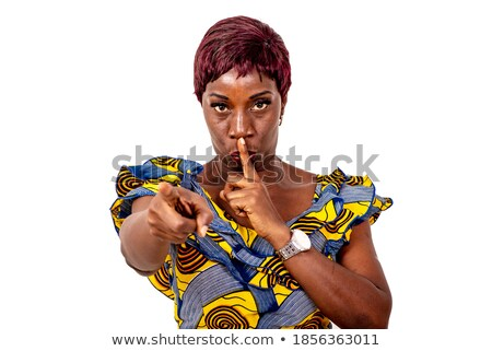 Serious business woman making silence sign Stock photo © stockyimages