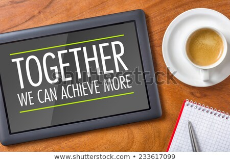 tablet on a desk   together we can achieve more stock photo © zerbor