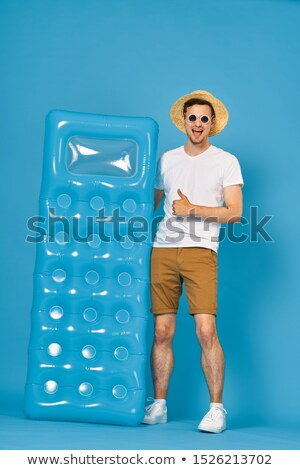 young boy with beach mattress stock photo © nyul