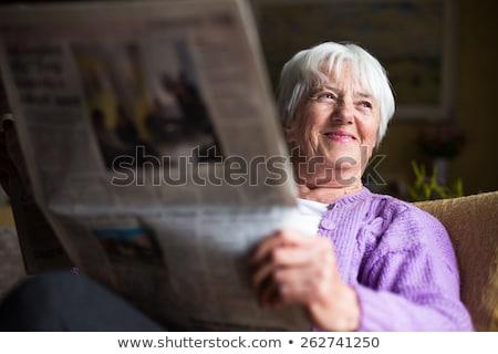 Senior woman reading morning newspaper Stock photo © lightpoet
