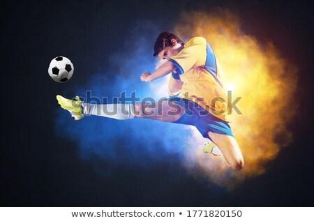 football player in yellow kicking ball stock photo © wavebreak_media