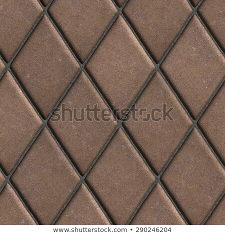 Paving  Slabs Brown Laid in the Form of Rhombuses. Stock photo © tashatuvango