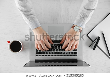 Stock photo: Humans hand working on laptop, top view