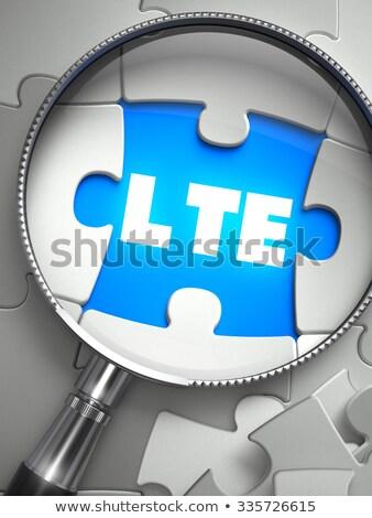 LTE - Missing Puzzle Piece through Magnifier. Stock photo © tashatuvango