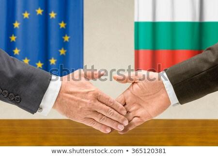 Representatives of the EU and Bulgaria shake hands Stock photo © Zerbor
