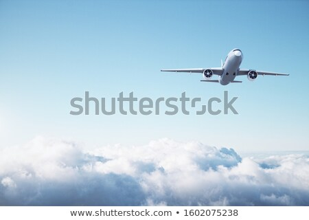 Aircraft wing flying in blue sky and clouds Stock photo © lunamarina