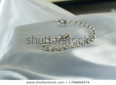 Lusso bracciale femminile accessori bianco tavolo in legno Foto d'archivio © hitdelight