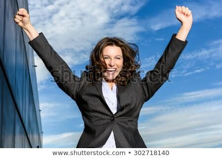 Encantado mulher de negócios saltando alegria falante Foto stock © vlad_star