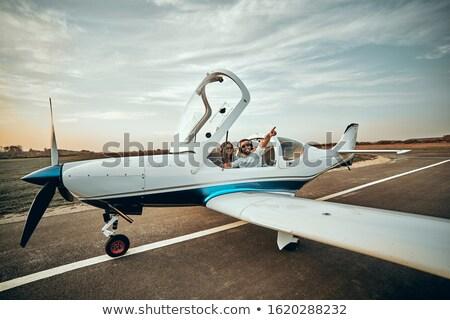 pequeno · avião · dia · voador · aeronave · blue · sky - foto stock © deandrobot