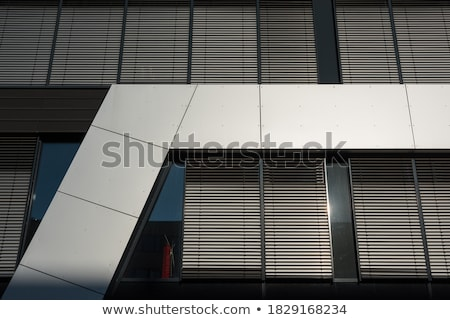 pattern of office facade with windows and shutter blinds  Stock photo © meinzahn