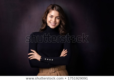 Portrait of the young beautiful girl on a dark background Stock photo © ISerg