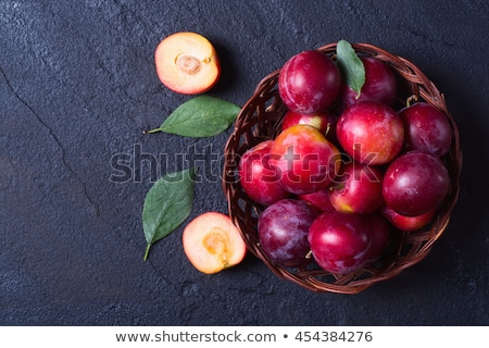plate of fresh plums Stock photo © Digifoodstock
