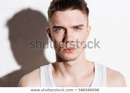 クローズアップ 若い男 青い目 白 顔 男 ストックフォト © deandrobot