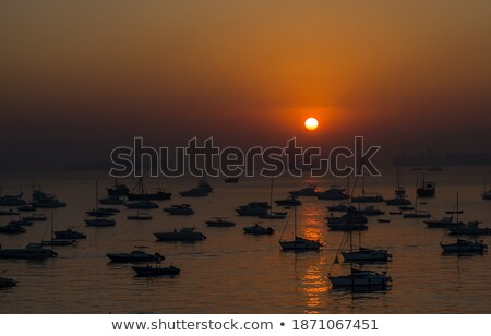 Pôr do sol oceano espetacular sol Foto stock © meinzahn