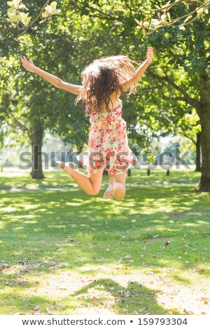 Woman leaping by tree Stock photo © IS2