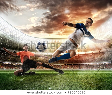 Football scene with competing football players at the stadium Stock photo © alphaspirit