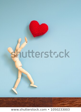 Wooden figurine jumping in the air Stock photo © wavebreak_media