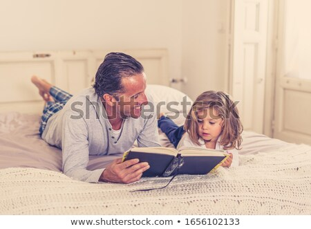 Young girl on bed with book Stock photo © IS2