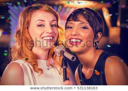 Közelkép mikrofon fiatal női barátok éjszakai klub Stock fotó © wavebreak_media