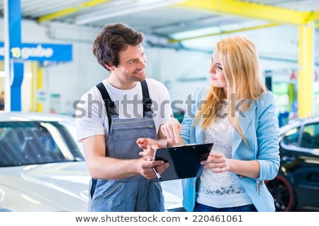 Client and mechanic checking defects in the car Stock photo © Kzenon