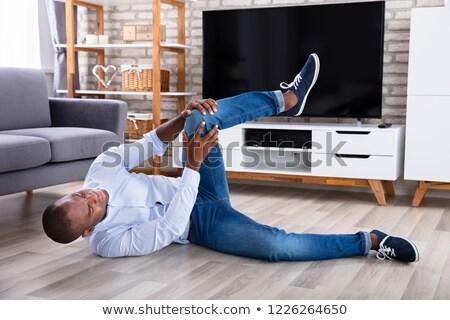 Człowiek kolano objętych piętrze młodych Zdjęcia stock © AndreyPopov