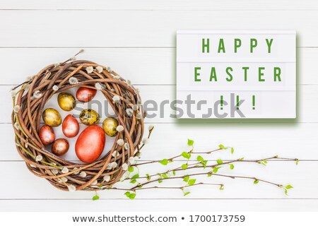 Stock photo: Eggs and willow and green branches  in wooden box