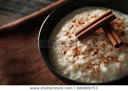 Riz au lait dessert savoureux décoré lapin de Pâques coloré Photo stock © Melnyk