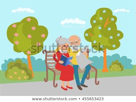 Cute ouderen paren boeken krant grijs haar Stockfoto © robuart