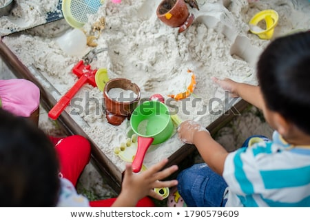 wet toddler girl playing with toys on sand at beach stock photo © andreypopov