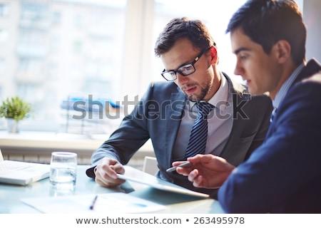Grave empresario reunión colegas dos mirar Foto stock © Giulio_Fornasar