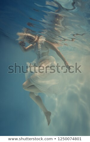 Female floating in natural blue pools Stock photo © lovleah
