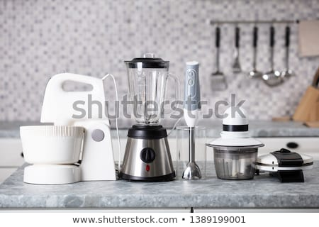 On kitchen counter top closeup in row kitchen appliances for eas Stock photo © amok