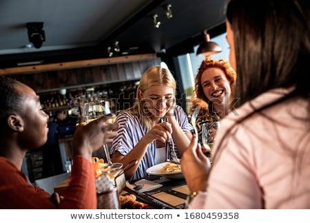 Arkadaşlar yeme tablo lokanta içme meyve suyu Stok fotoğraf © boggy