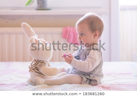 Egyéves lány ágy szórakozás szeretet gyermek Stock fotó © Lopolo