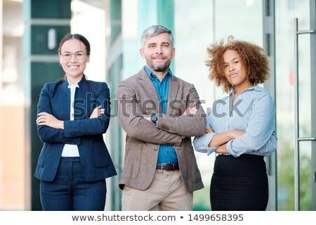 Kettő fiatal multikulturális nők üzletember karok Stock fotó © pressmaster