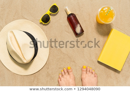 Stock photo: Feet Hat Shades Sunscreen And Book On Beach