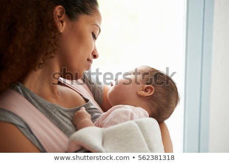 close up of african american mother and daughter sleeping together on bed in bedroom at home stock photo © wavebreak_media