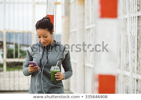 woman with smartphone and shake listening to music Stock photo © dolgachov