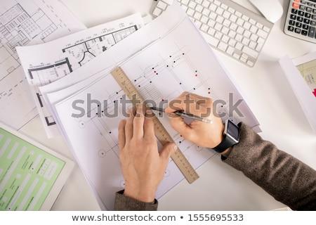 Mains ingénieur crayon souverain dessin ligne Photo stock © pressmaster
