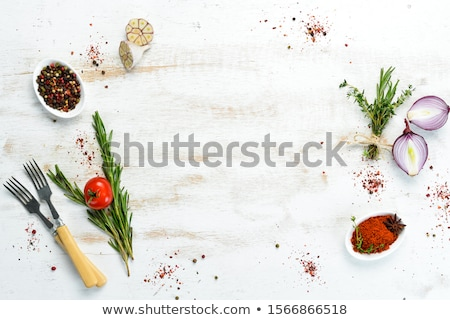 Fresh herbs and oils, wooden table background Stock photo © JanPietruszka