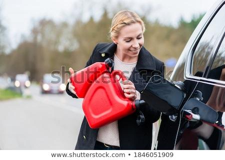 женщину заполнение автомобилей вверх газ Сток-фото © Kzenon