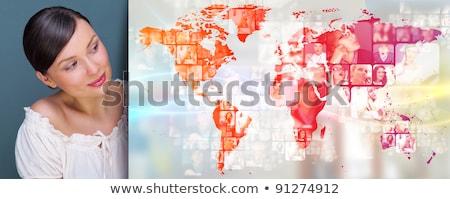 portret · jonge · vrouw · permanente · groot · wereldkaart · naar - stockfoto © hasloo