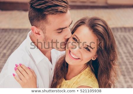 Uomo bacio donna guancia computer Coppia Foto d'archivio © photography33