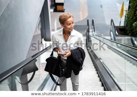 деловые люди эскалатор женщины счастливым работу технологий Сток-фото © photography33